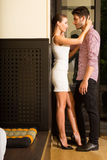 A young couple flirting at the door Royalty Free Stock Photos
