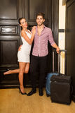 A young couple flirting at the door Stock Photography
