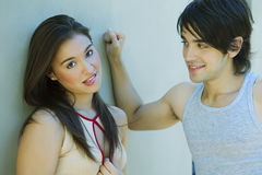 Young couple flirting. Happy young couple flirting outdoors Stock Images