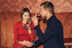 Young couple flirting at restaurant and drinking wine Royalty Free Stock Image