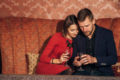 Young couple flirting at restaurant and drinking wine. Young couple flirting in the restaurant on a date.first date,love Royalty Free Stock Photography