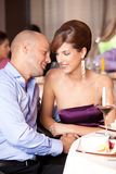 Young couple flirting at restaurant table Royalty Free Stock Image