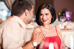 Young couple flirting at restaurant table. Happy couple flirting at restaurant table Stock Photography