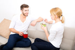 Young couple flirting on the Sofa Stock Photography