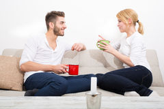 Young couple flirting on the Sofa Royalty Free Stock Photo