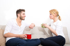 Young couple flirting on the Sofa Royalty Free Stock Image