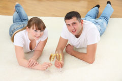 Young couple on a floor Stock Images