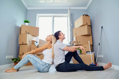 Young couple on the floor in a new house. stock images