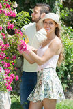 Young couple in flowers garden Stock Image