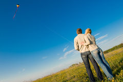 Young couple flying a kite. Happy young couple in love flying a kite stock photos