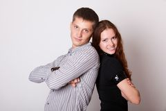 Young couple with folded hands Royalty Free Stock Photography