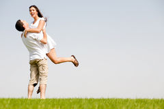 Young Couple Fooling Around On The park Stock Image