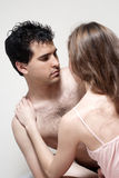 Young couple during foreplay in bed Royalty Free Stock Photo