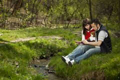 Young couple in a forest Stock Images