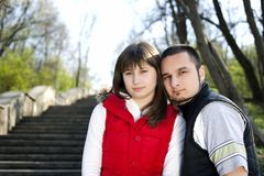 Young couple in a forest Royalty Free Stock Photo