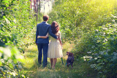 Young couple in forest with dog Royalty Free Stock Photography