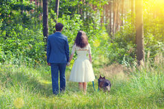 Young couple in forest with dog Stock Images