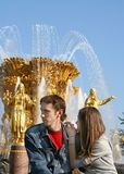 Young couple at a fountain stock photography