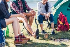 Young couple and friend sitting on chair discuss together campin Royalty Free Stock Images