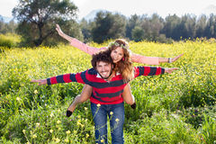 Young couple frolicking in the countryside. stock photos