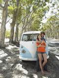 Young Couple in Front of Camper Van Royalty Free Stock Photography