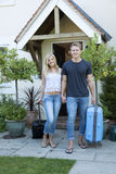 Young couple at the front door of a house Stock Images