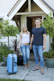 Young couple at the front door of a house Royalty Free Stock Photos