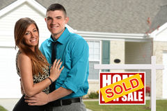 Young Couple In Front of New Home Stock Photo