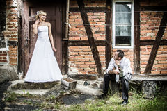 Young couple in front of the old house royalty free stock image