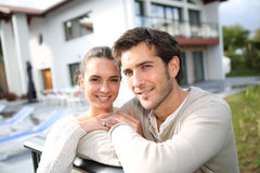 Young couple in front of their home Royalty Free Stock Photos