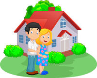 Young couple in front of their house Stock Photography