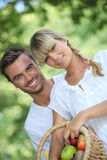 Young couple with fruit basket Royalty Free Stock Image