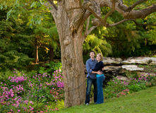 Young Couple in the Garden Stock Photography