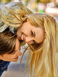 Young couple gently hugging and flirting in  park Stock Photo