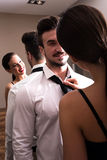 A young couple getting dressed in the changing room Stock Photo