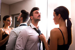 A young couple getting dressed in the changing room Royalty Free Stock Images