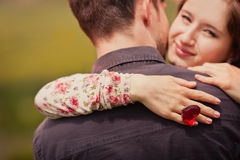 Young couple getting engaged. With big heart ring Stock Images