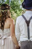 Young couple getting married. Cropped photo of a beautiful couple from behind on their wedding day Stock Photos