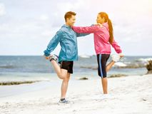 Young couple getting ready to run at the seaside Stock Photos