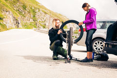 Young Couple Getting Their Bikes Ready Royalty Free Stock Image