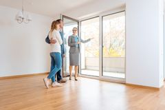 Young couple getting tour through apartment they consider renting. Or purchasing royalty free stock images
