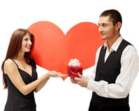 Young couple with a gift Royalty Free Stock Photo