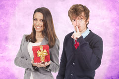 Young couple with gift Royalty Free Stock Photos