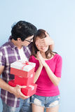 Young couple with gift Stock Images
