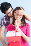 Young couple with gift Royalty Free Stock Images