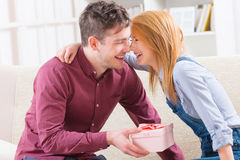 Young couple with gift Royalty Free Stock Photo