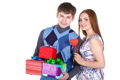 Young couple with gifts Royalty Free Stock Photos