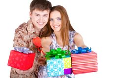 Young couple with gifts Stock Photos