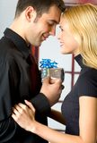 Young couple with gifts Stock Photo