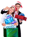 Young couple with gifts in Christmas Royalty Free Stock Images